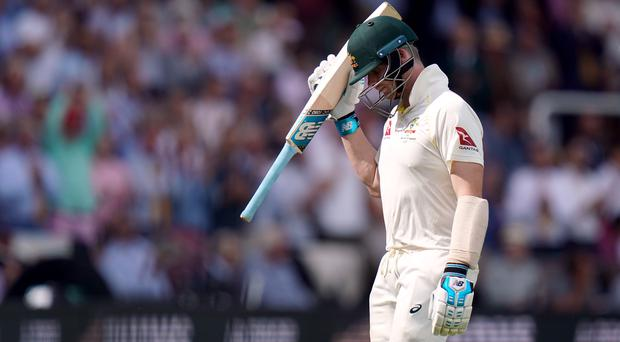 Australia's Steve Smith leaves the pitch after being dismissed following his return after being struck by Jofra Archer (John Walton/PA)