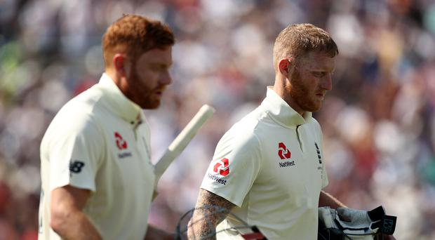 England's Ben Stokes (right) and Jonny Bairstow (left) walk off for lunch during day four of the third Ashes Test match at Headingley (Tim Goode/PA)