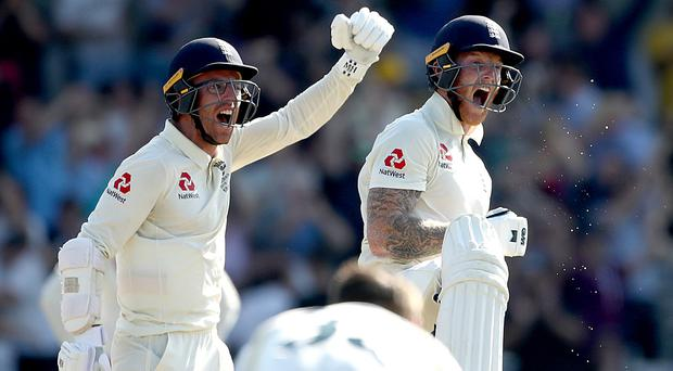 Ben Stokes, right, and Jack Leach celebrate England's astonishing win at Headingley (Tim Goode/PA)