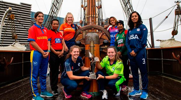 Final prize: Ireland's Laura Delany (front right) with the T20 World Cup qualifying trophy and the other seven captains