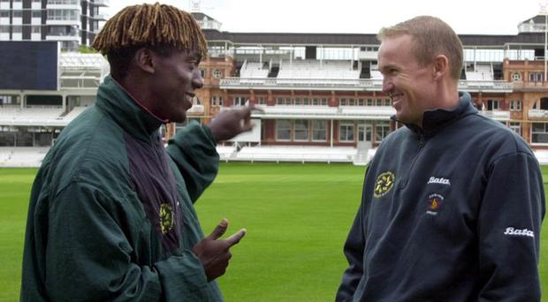 Henry Olonga chats with captain Andy Flower at Lord's in 2000.