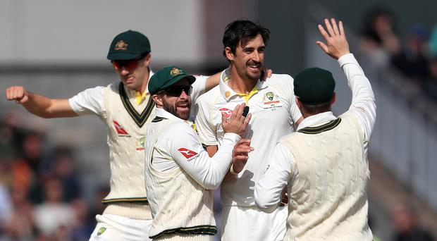 Australia's Mitchell Starc (centre) celebrates taking the wicket of England's Stuart Broad (Mike Egerton, PA)