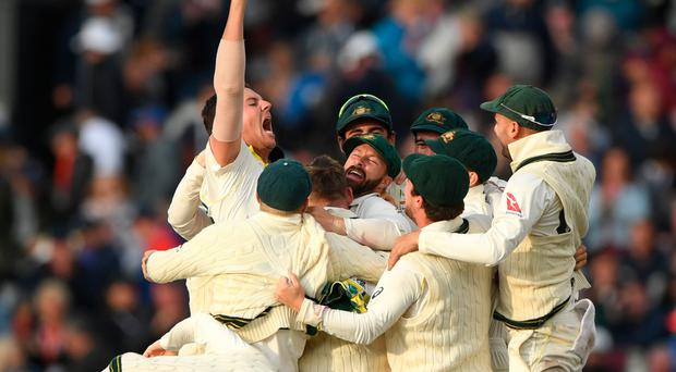 Over and out: Australia bowler Josh Hazlewood celebrates after taking the final wicket of England batsman Craig Overton to retain the Ashes