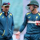 Justin Langer, left, plans to persist with out-of-form David Warner, right (Bradley Collyer/PA)