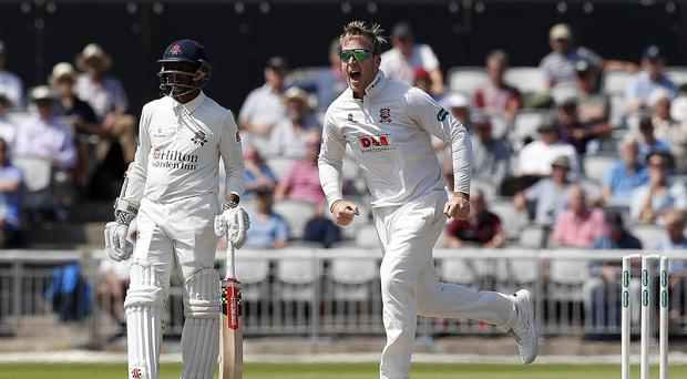 Simon Harmer spun Essex to victory over Surrey with seven wickets (Martin Rickett/PA)