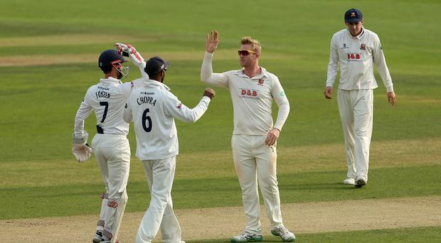Simon Harmer, second right, has been pivotal for Essex (Steven Paston/PA)