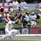 England's Rory Burns watches as the ball that hit his helmet is caught by New Zealand's Tim Southee in the slips during play on day one of the first cricket test between England and New Zealand at Bay Oval in Mount Maunganui on Thursday (Mark Baker/AP)