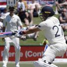 England's Rory Burns swings and misses at the ball during play on day one of the first cricket test between England and New Zealand at Bay Oval in Mount Maunganui (Mark Baker/AP)