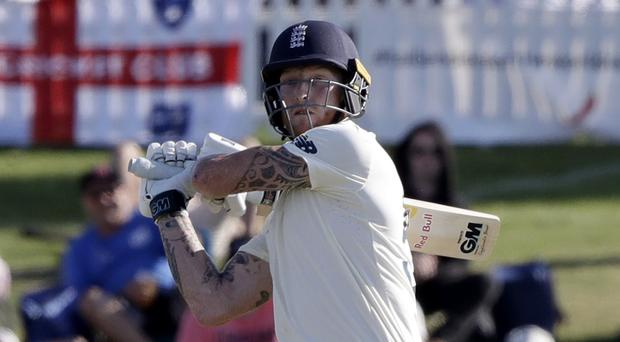 England's Ben Stokes on his way to an unbeaten half century on day one of the first Test in New Zealand (Mark Baker/AP)