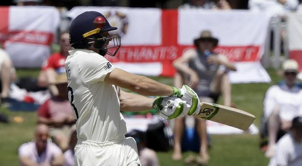 England's Jos Buttler swings at the ball during play on day two of the first cricket test between England and New Zealand at Bay Oval in Mount Maunganui on Friday (Mark Baker/AP)