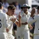 Sam Curran, centre, dismissed New Zealand captain Kane Williamson (Mark Baker/AP)
