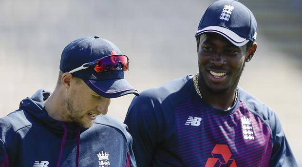 Jofra Archer, right, and Joe Root were all smiles in practice (Mark Baker/AP)