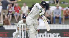 New Zealand's Tom Latham bats during play on day one of the second cricket test between England and New Zealand (Mark Baker/AP)