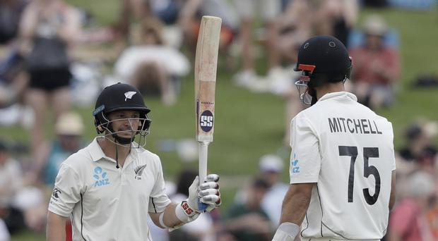 New Zealand's BJ Watling, celebrates after reaching a half century with teammate Daryl Mitchell (Mark Baker/AP)