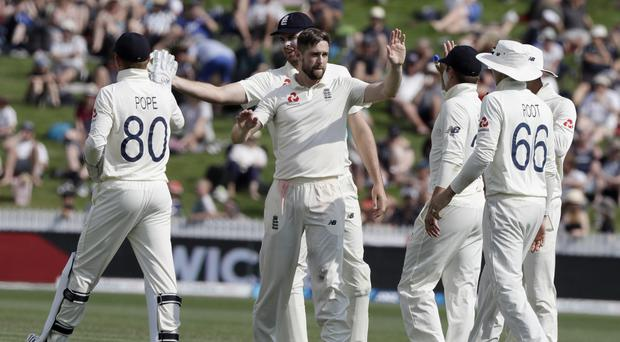 England's Chris Woakes, centre, is congratulated by teammates after dismissing New Zealand's Tim Southee (Mark Baker/AP)