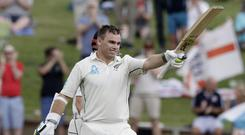 New Zealand's Tom Latham celebrates reaching three figures (AP)