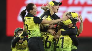 Australia celebrate after defeating India in the Women's T20 World Cup final (Asanka Ratnayake/AP).