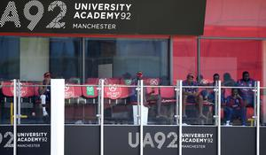 West Indies players look on from the dressing room balcony at Old Trafford (Gareth Copley/PA)