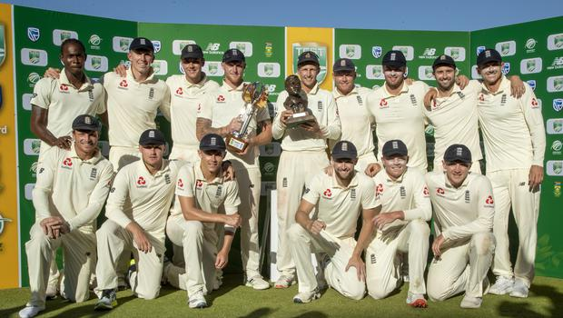 England players pose for photographers after receiving their trophy at the end of day four of the fourth cricket test match between South Africa and England at the Wanderers stadium in Johannesburg, South Africa, Monday, Jan. 27, 2020. England beat South Africa by 191 runs to win 3-1 series. (AP Photo/Themba Hadebe)