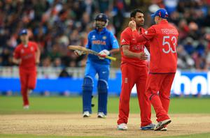 Ravi Bopara, second right, and James Tredwell got England back on track with crucial wickets (Mike Egerton/PA)