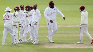 Rahkeem Cornwall (second right) produced an incredible reaction catch to dismiss Rory Burns (Martin Rickett/PA)