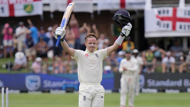England's Ollie Pope celebrates making his hundred on day two (Michael Sheehan/AP)