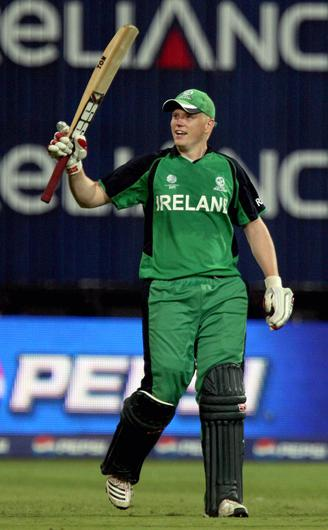 Kevin O'Brien celebrates after completing his century