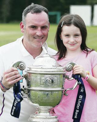 Neil Russell has landed a new job with Manchester City. The Comber man is also an avid cricketer and captained Instonians to league glory in 2014. He is pictured celebrating that success with daughter Evie.