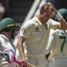 Stuart Broad, centre, has been fined for swearing during the fourth Test (Themba Hadebe/AP)
