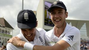 England's Stuart Broad, right, and Sir Alastair Cook celebrate after winning the Ashes (PA)
