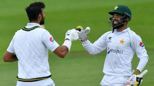 Pakistan's Shan Masood celebrates his century with Shadab Khan (Dan Mullan/PA)