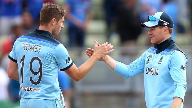 Chris Woakes (left) and Eoin Morgan played key roles in England's World Cup success (Nigel French/PA).