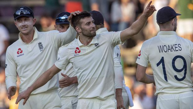 England's Mark Wood, middle, celebrates with team-mates after dismissing South Africa's batsman Anrich Nortje on day two of the fourth Test (AP/Themba Hadebe).