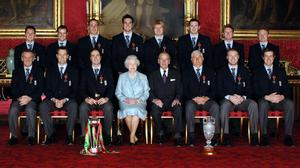 England's 2005 Ashes winning team sit with Queen Elizabeth II and the Duke of Edinburgh in Buckingham Palace (Fiona Hanson/PA)
