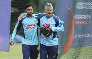 Steve Rhodes, right, is proud of the World Cup performance of his team (Aijaz Rahi/AP)