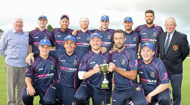 Champions: CIYMS celebrate with the Lagan Valley Steels T20 Cup at The Lawn yesterday