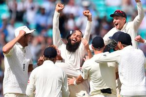 Treble yell: Moeen Ali is mobbed by his England team-mates after taking the first ever Test hat-trick at The Oval