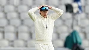 Joe Root's side were frustrated by rain on day three in Manchester (John Super/NMC Pool)
