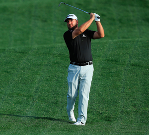 Good eye: Graeme McDowell plays his second shot on the fourth hole at Sawgrass