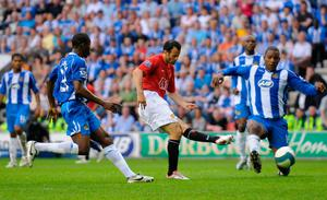 Sealed: Ryan Giggs scores against Wigan to clinch the title