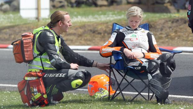 Helping hand: Maria is treated by Dr John Hinds after crashing at the North West in 2014