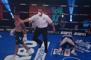 Walking tall: Carl Frampton leaves Darren Traynor on the canvas in round six
