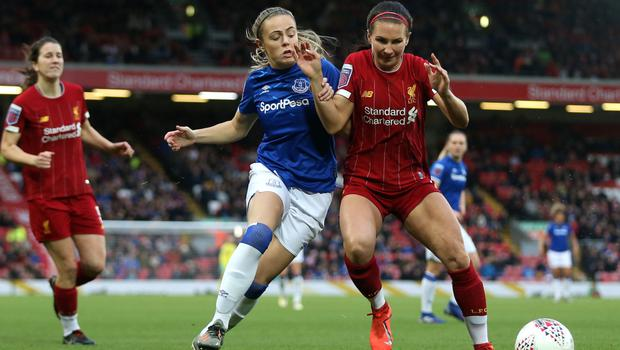 Big stage: Simone Magill (left) tackling Leighanne Robe at Anfield