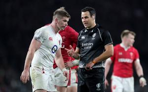 Take heed: Referee Ben O'Keeffe has a word with England captain Owen Farrell