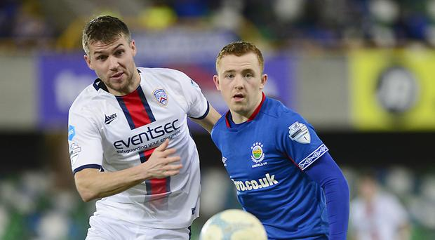 Close eye: Coleraine ace Stephen Lowry keeps track of Linfield's Shayne Lavery at Windsor