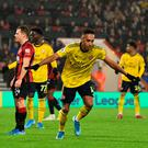 On target: Arsenal striker Pierre-Emerick Aubameyang celebrates scoring the equalister against Bournemouth