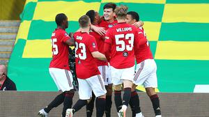 Harry Maguire, centre, scored Manchester United's winner at Carrow Road (Catherine Ivill/NMC Pool/PA)