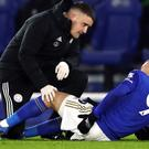 Leicester City's Jamie Vardy receives treatment before being substituted with an injury during the Premier League match at the King Power Stadium, Leicester.