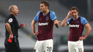 Referee Mike Dean showed a red card to West Ham midfielder Tomas Soucek (Clive Rose/PA)