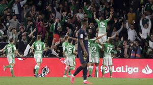Real Betis' Sidnei celebrates his opening goal in the LaLiga victory over Real Madrid (Miguel Morenatti/AP)